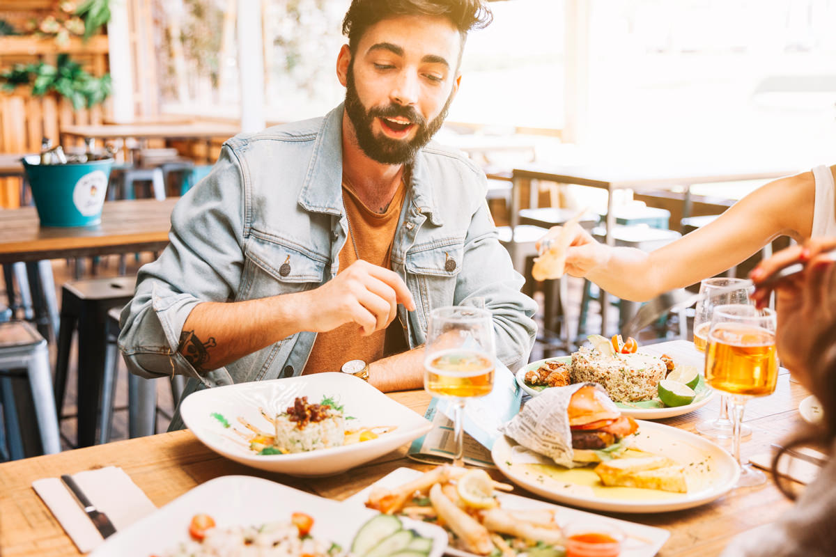 Man eating food in a restaurant